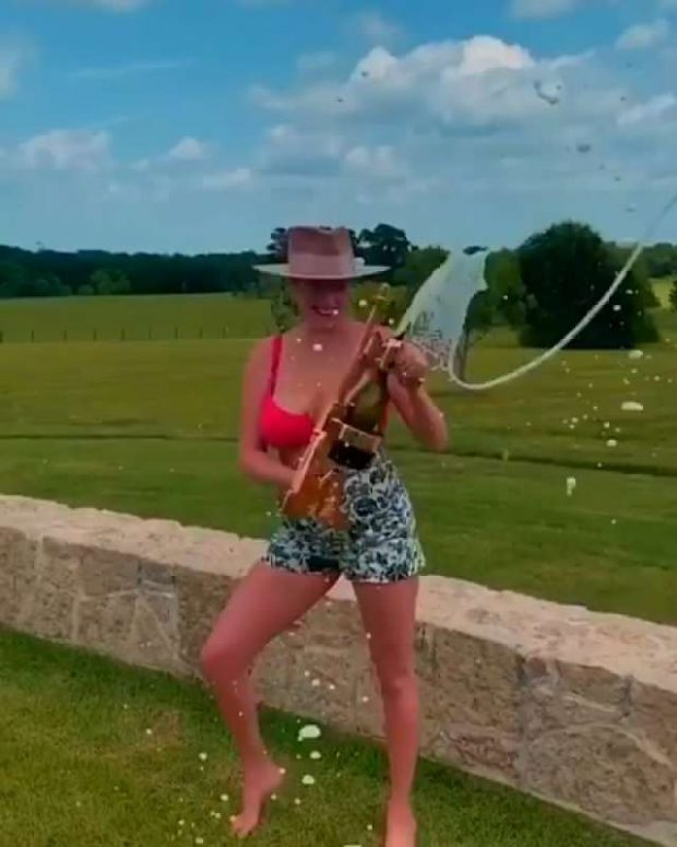 Kate Upton Popping Champagne - Instagram
