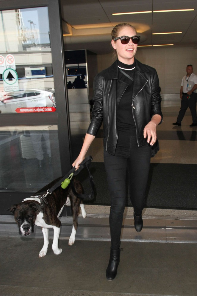 Kate Upton with her dog at LAX in Los Angeles
