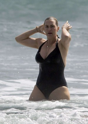 Kate Winslet in Black Swimsuit at a beach in Auckland