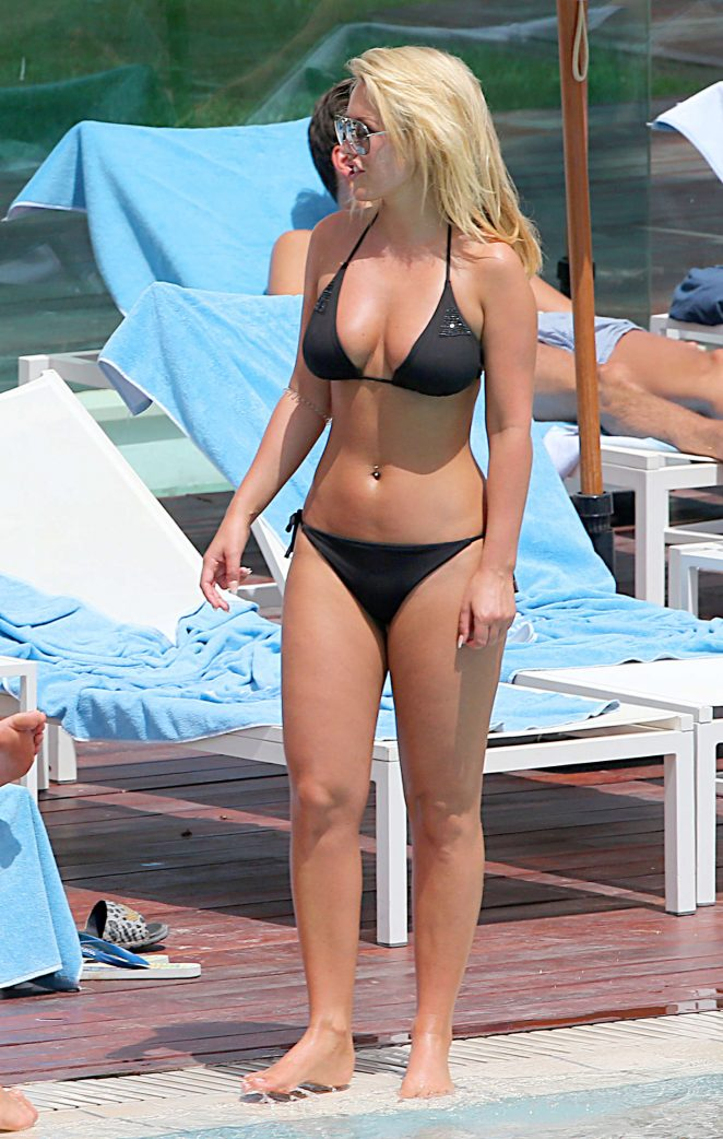 Kate Wright in Bikini at a pool in Magaluf