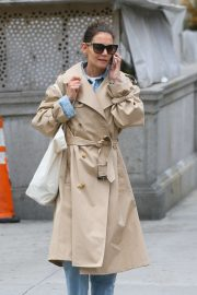 Katie Holmes in a trench coat as she takes a phone call out in New York City