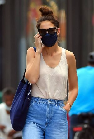 Katie Holmes - In denim and a peach tee shirt in New York