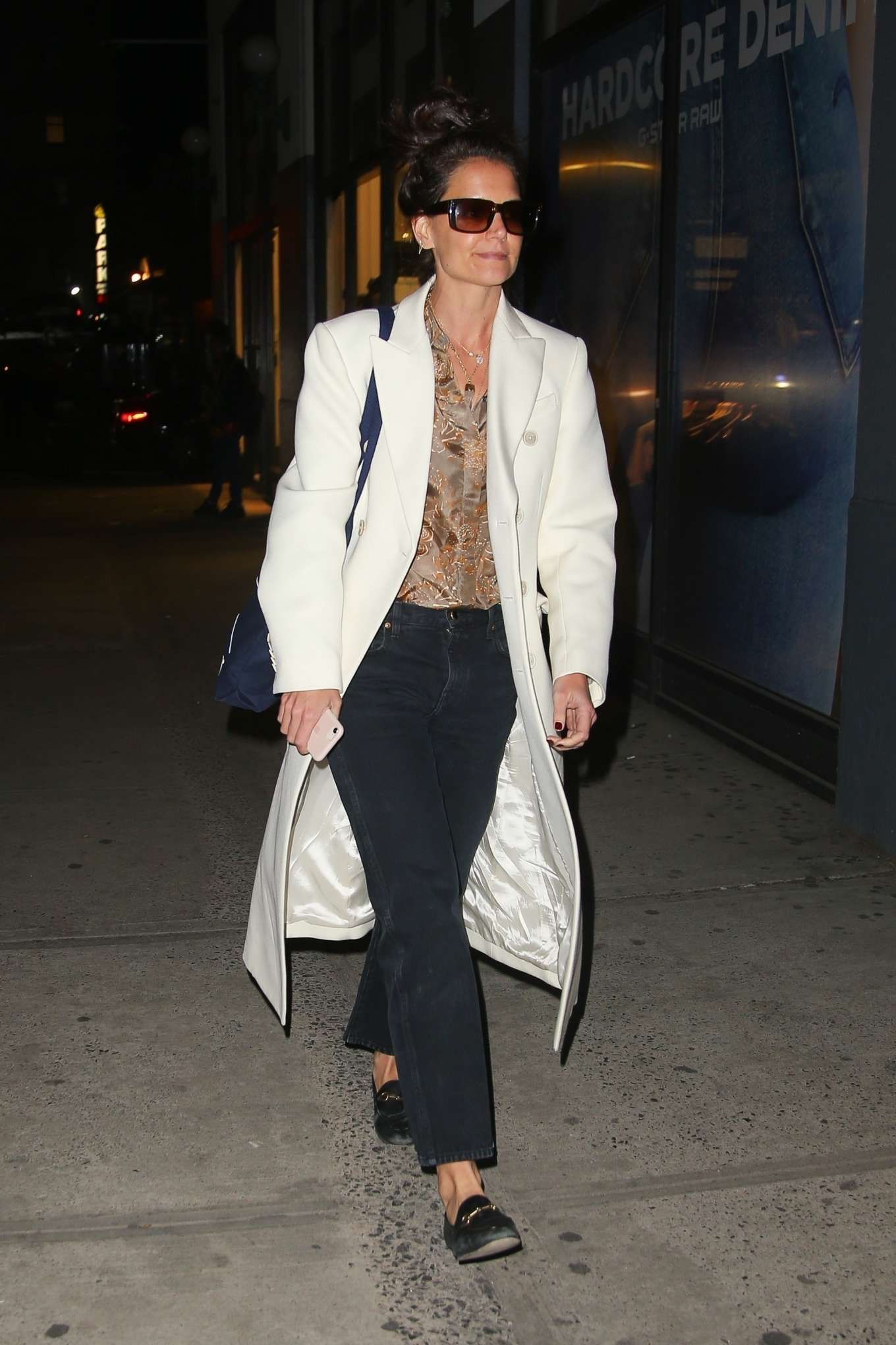Katie Holmes in white coat on a night out in NYC