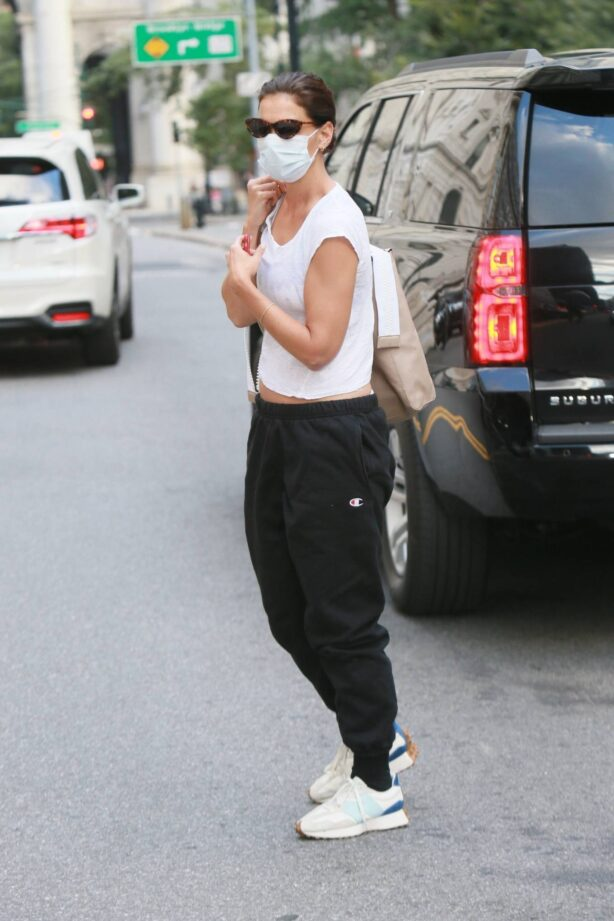 Katie Holmes - Was spotted wearing Champion sweatpants and a crop top in Manhattan