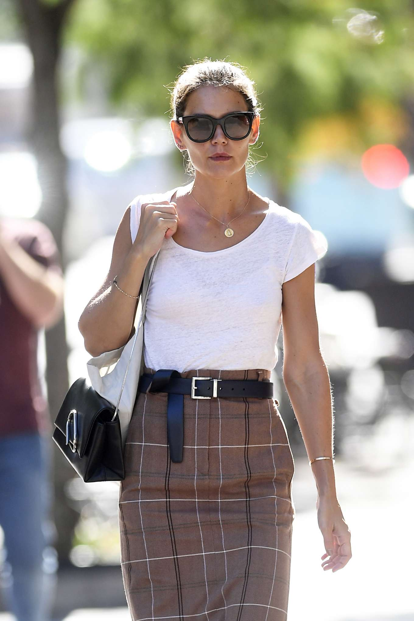 Katie Holmes wearing a plaid skirt in New York City
