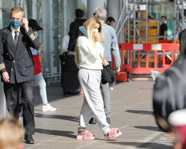 Katie Price - Seen arriving back at Stanstead airpor