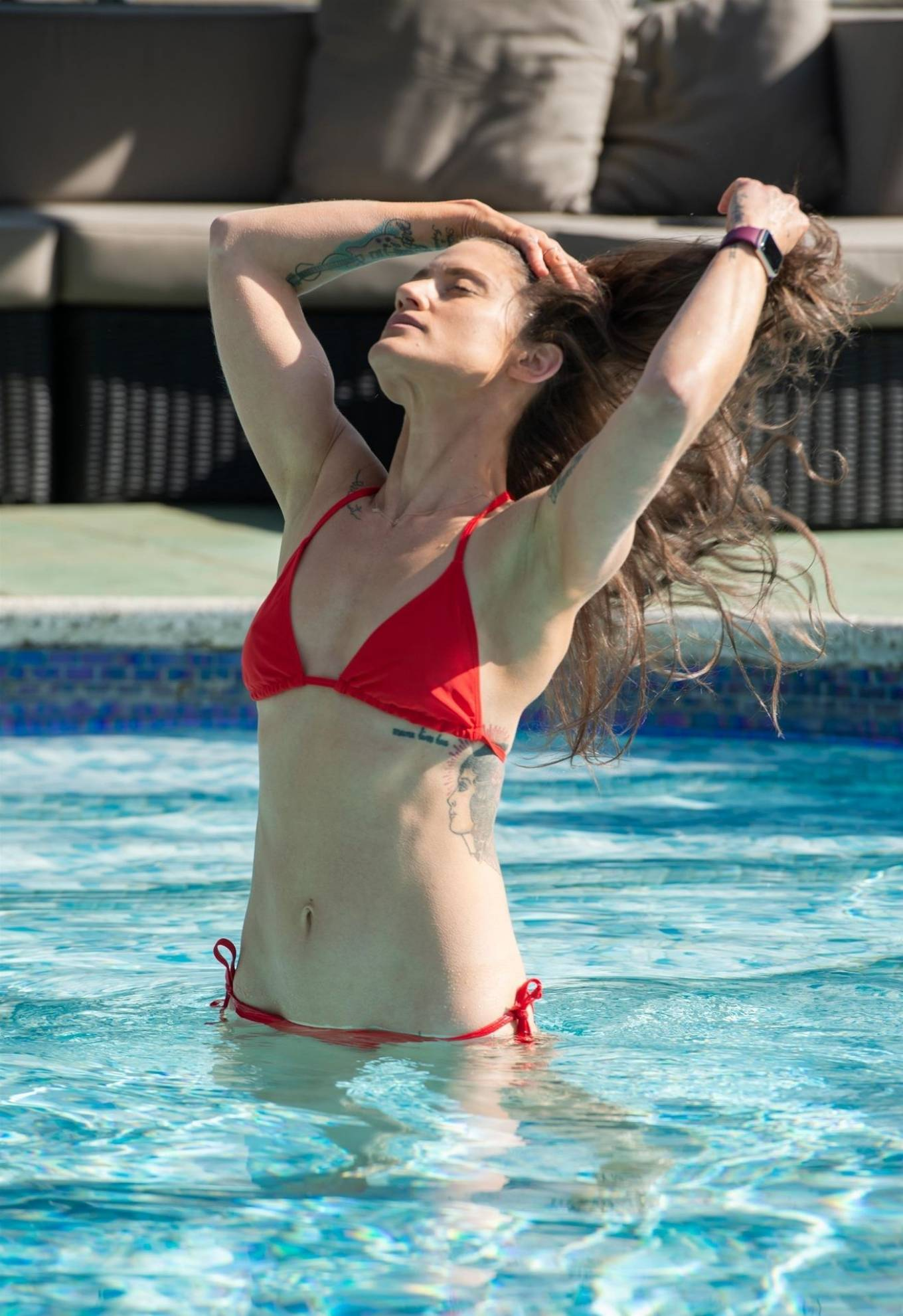 Katie Waissel - In red bikini at a pool during holidays in Italy