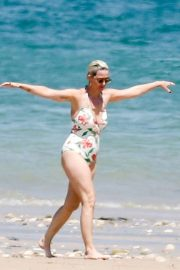Katy Perry in Floral Swimsuit with Orlando Bloom on the beach in Ile de Re