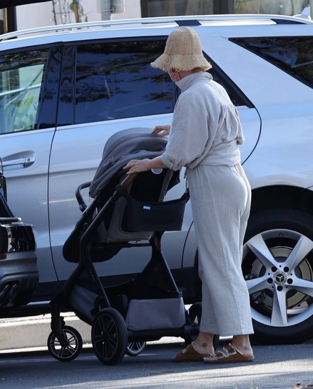 Katy Perry - Takes her little mini-me, Daisy Dove on a stroll in Montecito