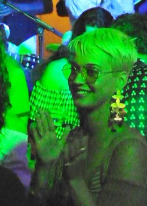 Katy Perry with a mystery man at a nightclub in Capri