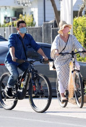 Katy Perry - With Orlando Bloom riding bikes in Santa Barbara