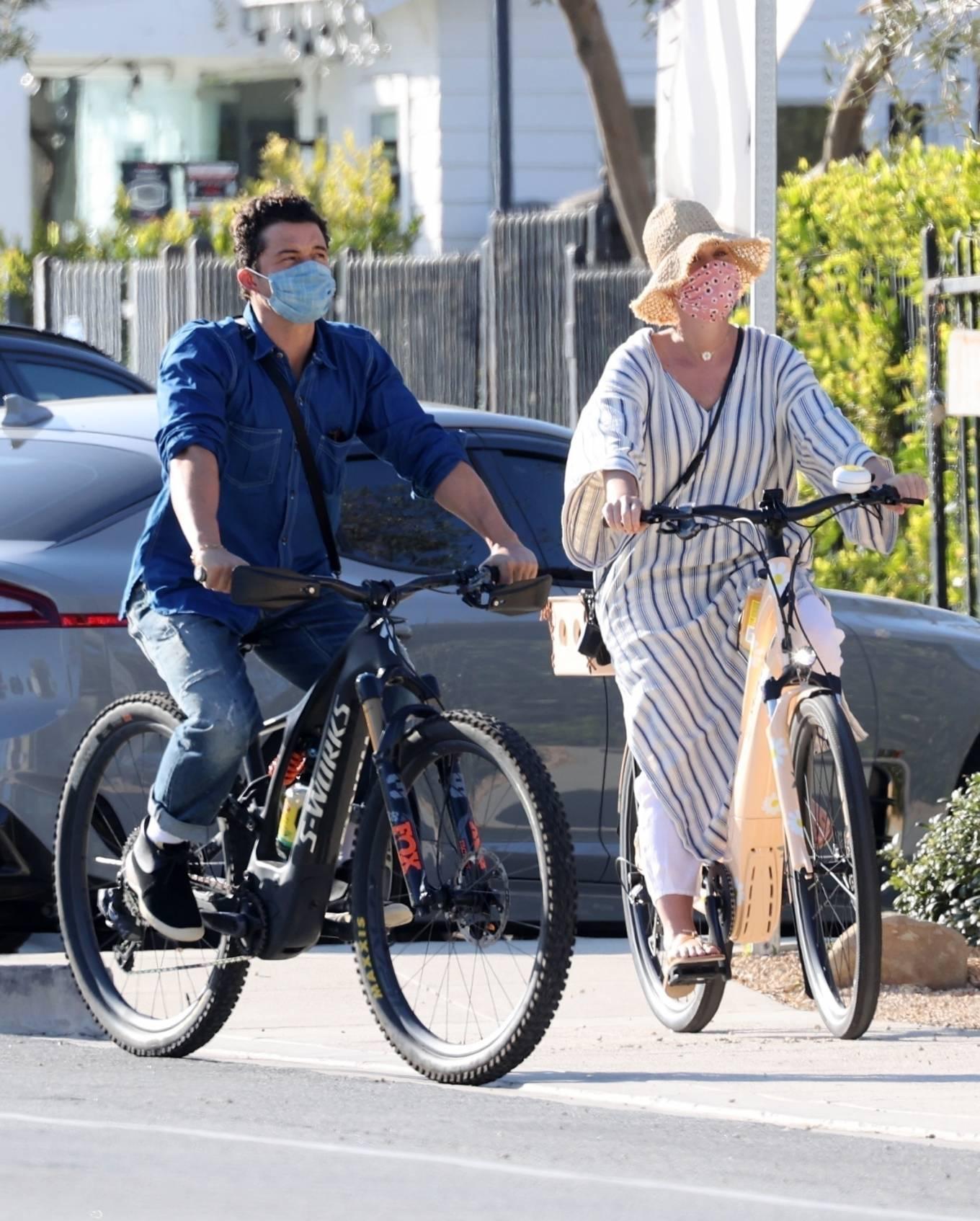Katy Perry - With Orlando Bloom riding bikes in Santa Barbara