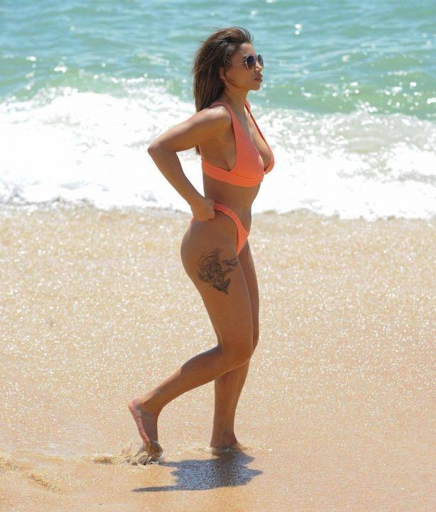 Kayleigh Morris - In orange bikini on the beach in Cyprus