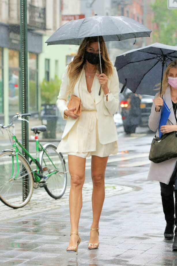 Kelly Bensimon - In a little white dress in the rain out in New York