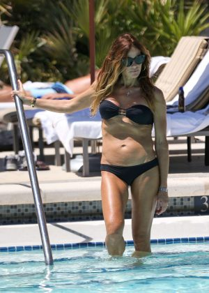 Kelly Bensimon in Black Bikini at a pool in Boca Beach
