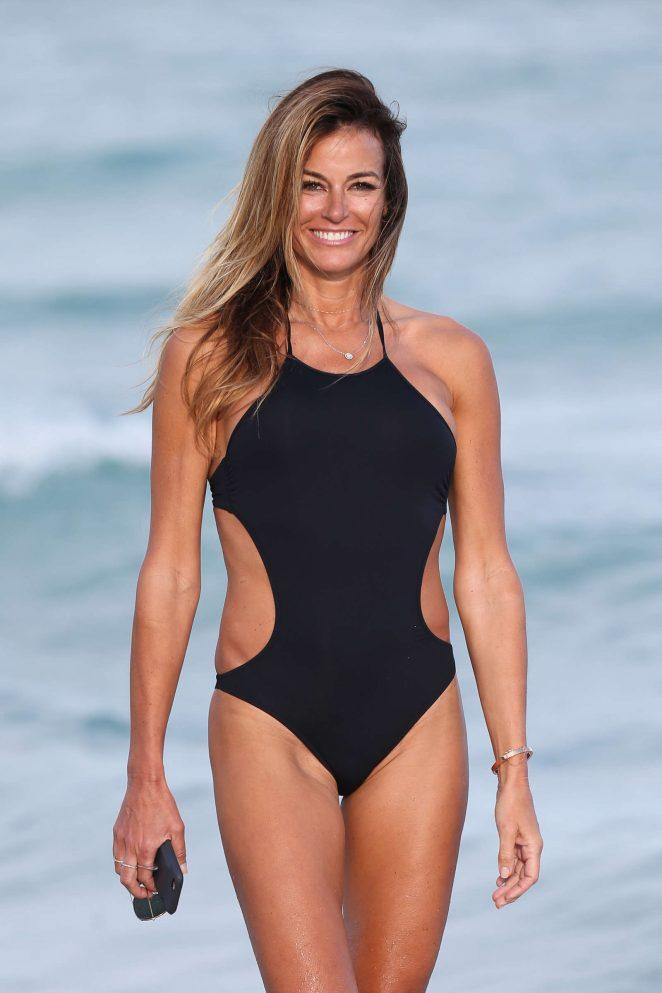 Kelly Bensimon in Black Swimsuit on Miami Beach