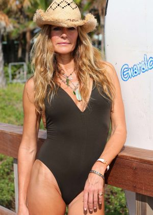 Kelly Bensimon in Black Swimsuit on vacation in Palm Beach