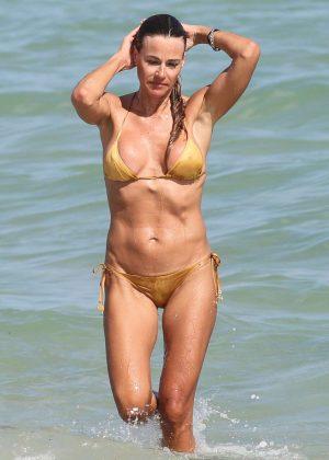 Kelly Bensimon in Gold Bikini in Miami