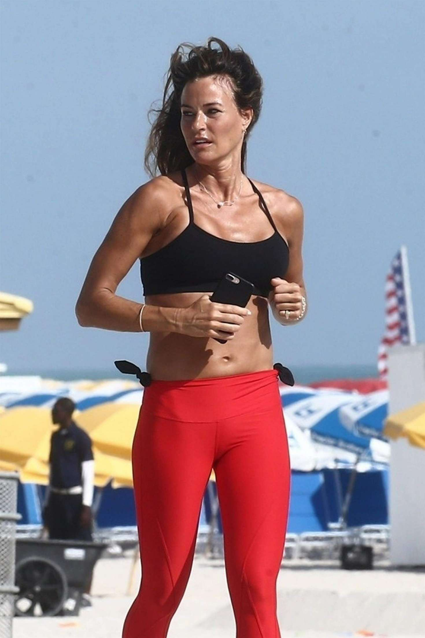 Kelly Bensimon in Red Tights - Jogging on the beach in Miami