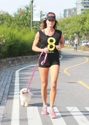 Kelly Bensimon in shorts jogging in Manhattan