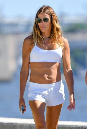 Kelly Bensimon in Shorts with her daughter goes for a walk in Palm Beach