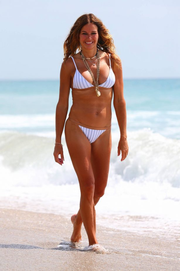 Kelly Bensimon in White Bikini on the beach in Palm Beach