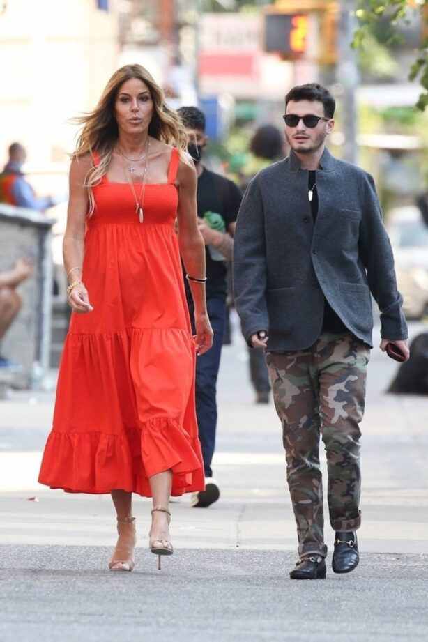 Kelly Bensimon - Out in a orange dress in New York