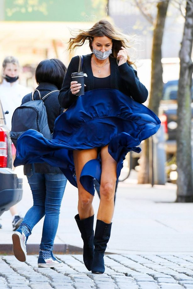 Kelly Bensimon - Out on windy day in New York