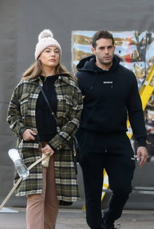 Kelly Brook and Jeremy Parisi take their puppy Teddy for a walk in Hampstead