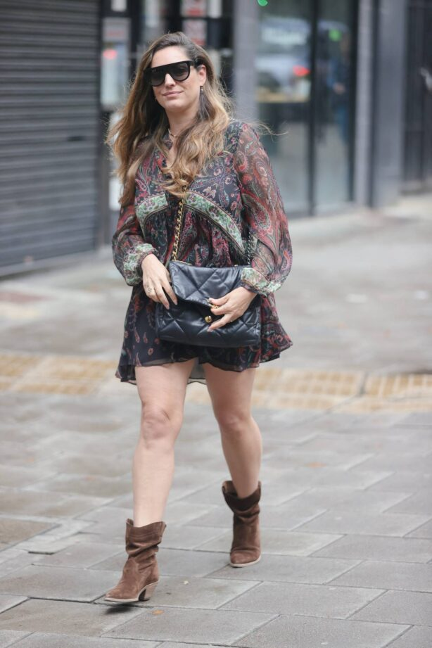 Kelly Brook - at Heart radio wearing a paisley minidress and suede boots in London
