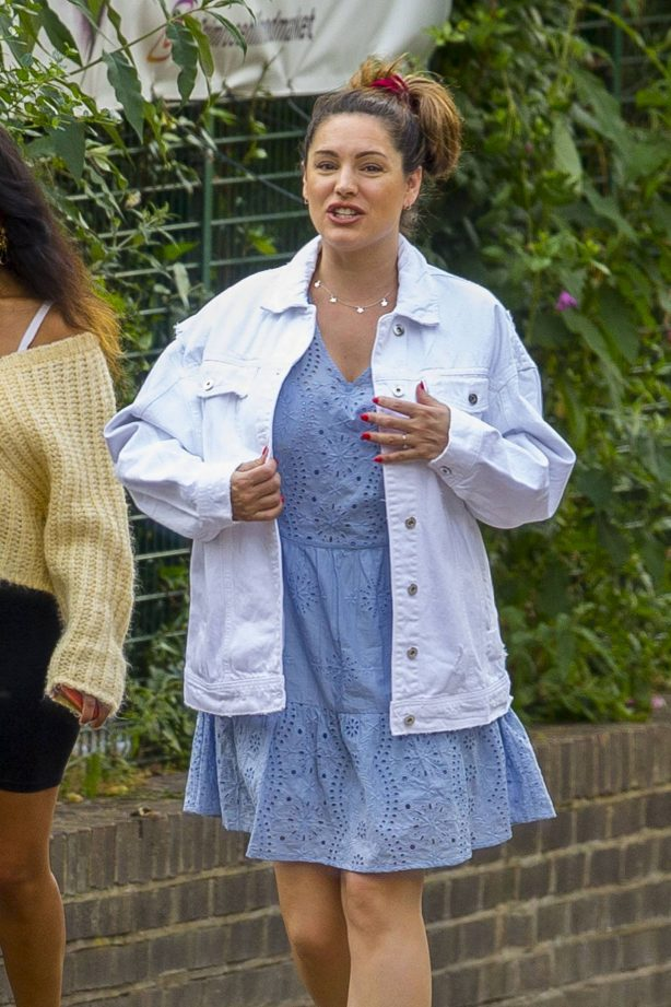 Kelly Brook in a broderie dress and denim jacket in London