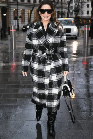Kelly Brook - In a checked coat and boots outside the Heart Radio Studios in London