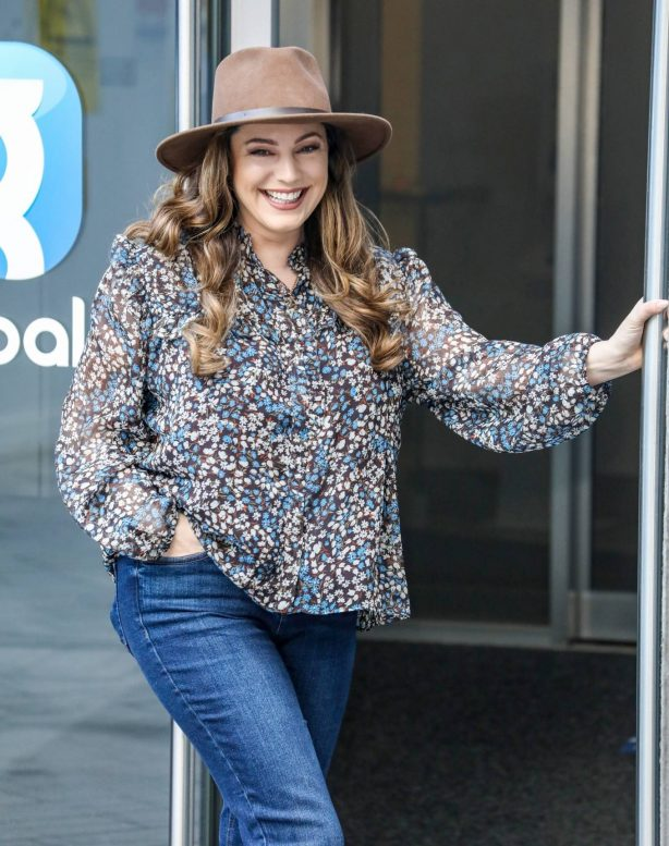 Kelly Brook - In a denim and hat at the Global Radio Studios in London