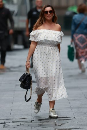 Kelly Brook - In a dotted off-the-shoulder summer dress at Heart Radio in London