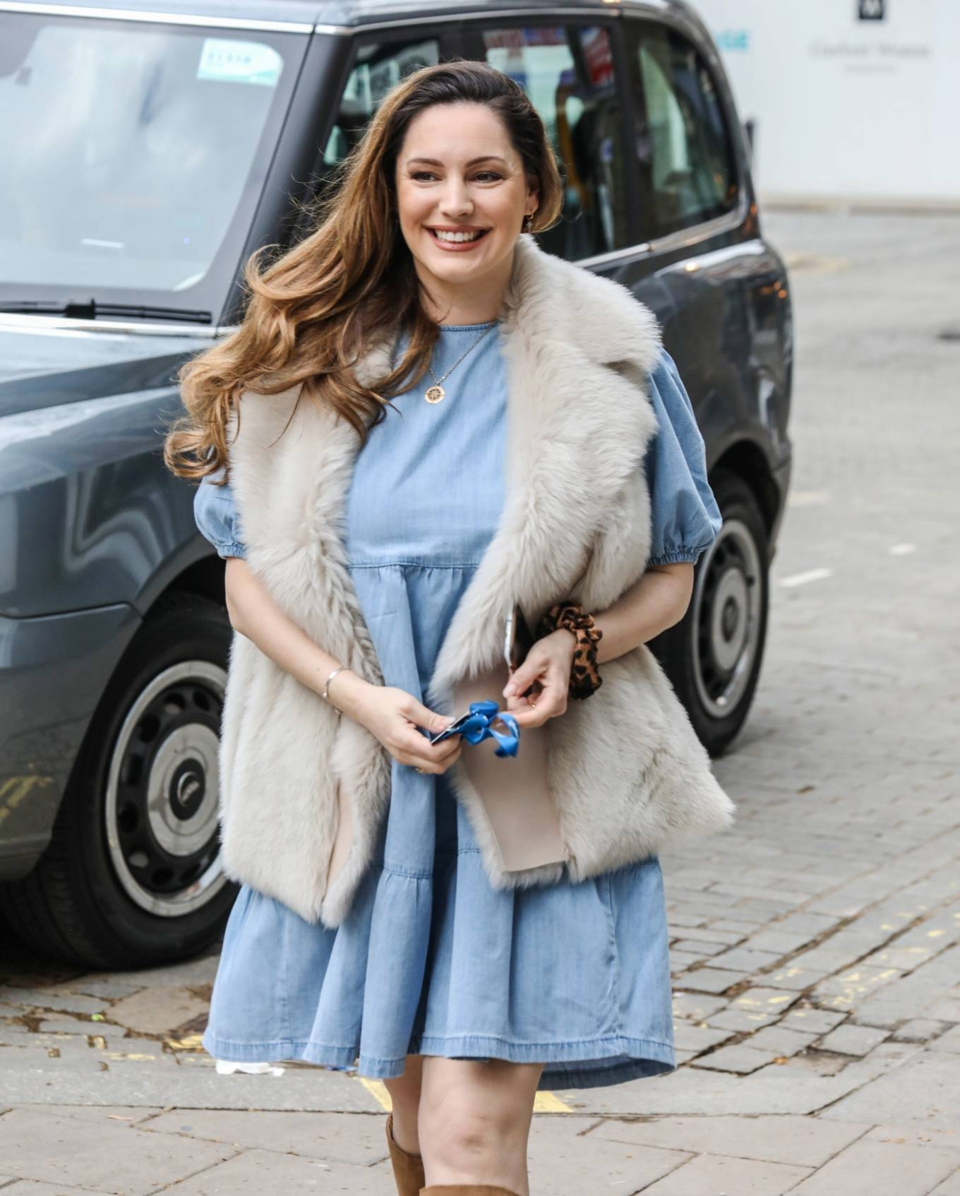 Kelly Brook - In a sky blue dress arriving for her Heart FM show at the Global Radio Studios