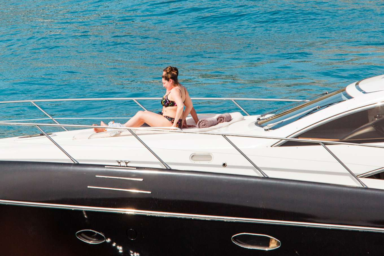 Kelly Brook in Bikini relaxed on a luxury yacht in Majorca