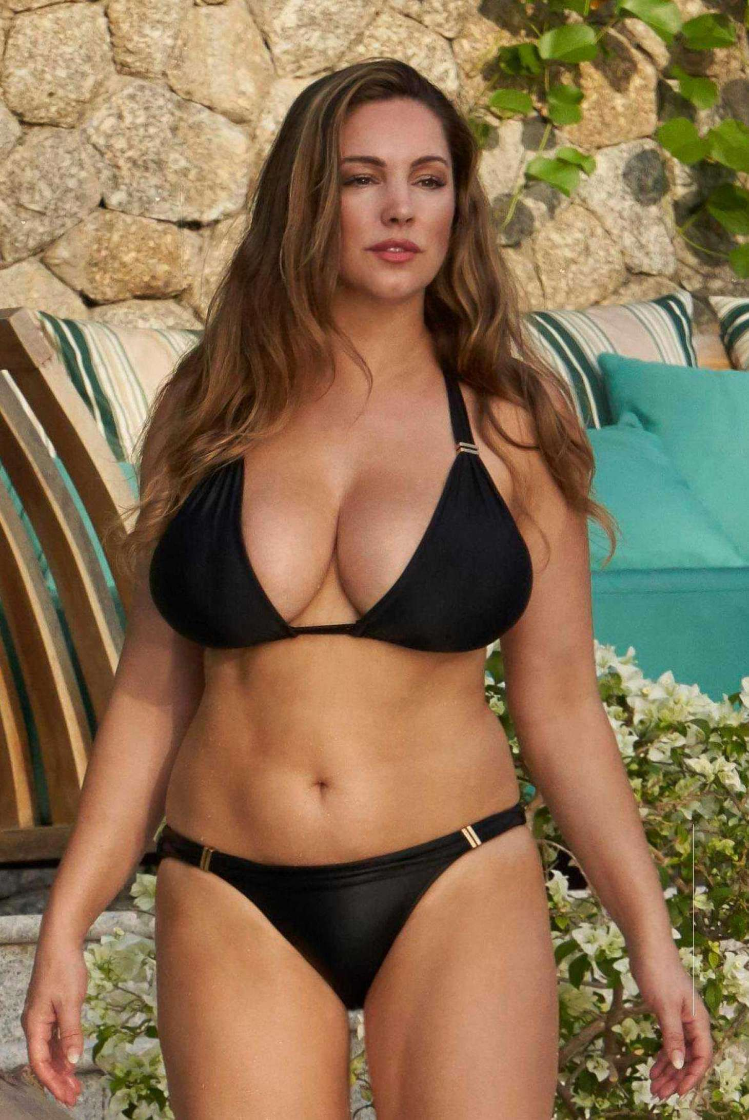 Kelly Brook in Black Bikini on the pool in Phuket adds