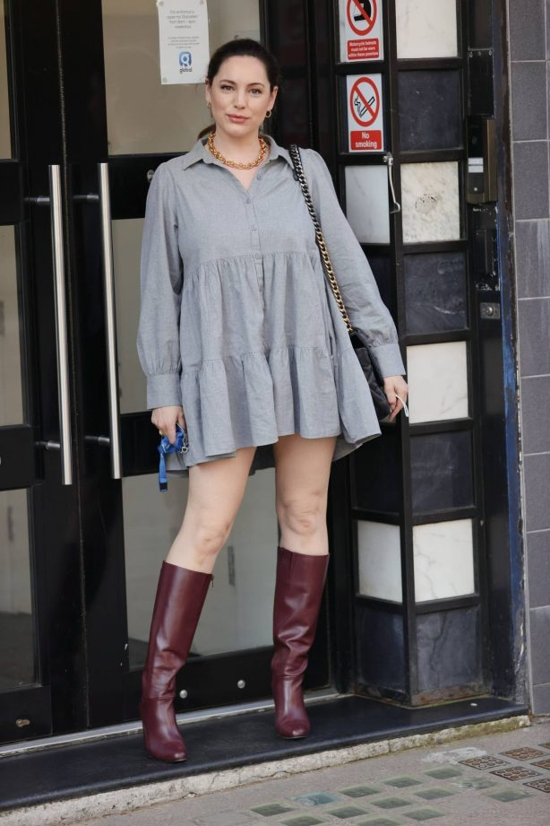 Kelly Brook - In floaty minidress and burgundy knee-high boots posing in London