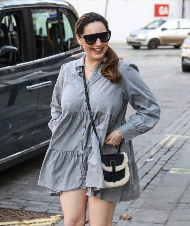 Kelly Brook - In grey dress at the Global Radio Studios in London