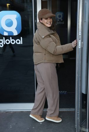 Kelly Brook - in peak cap trousers and jacket pictured at Heart radio in London