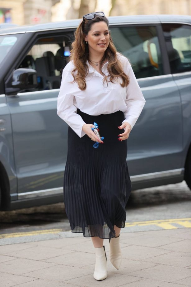Kelly Brook - In pleated skirt and blouse in London