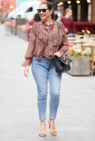 Kelly Brook - in tight denim and floral blouse at Heart radio in London