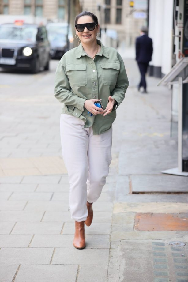 Kelly Brook - In white denim and green top in London