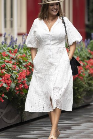 Kelly Brook - In white summer dress at Heart Radio in London