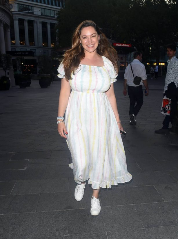 Kelly Brook - Is all smiles at Global Radio in London