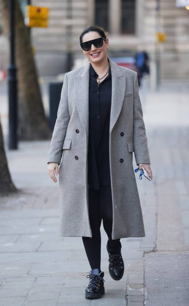 Kelly Brook - Looking chic in a black dress and grey coat in London