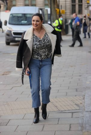 Kelly Brook - Looking chic in denim and floral blouse in London