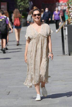 Kelly Brook - Looks sensational stepping out in a chiffon snakeskin dress in London