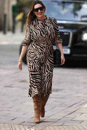 Kelly Brook - Looks stunning in a tiger print dress in London