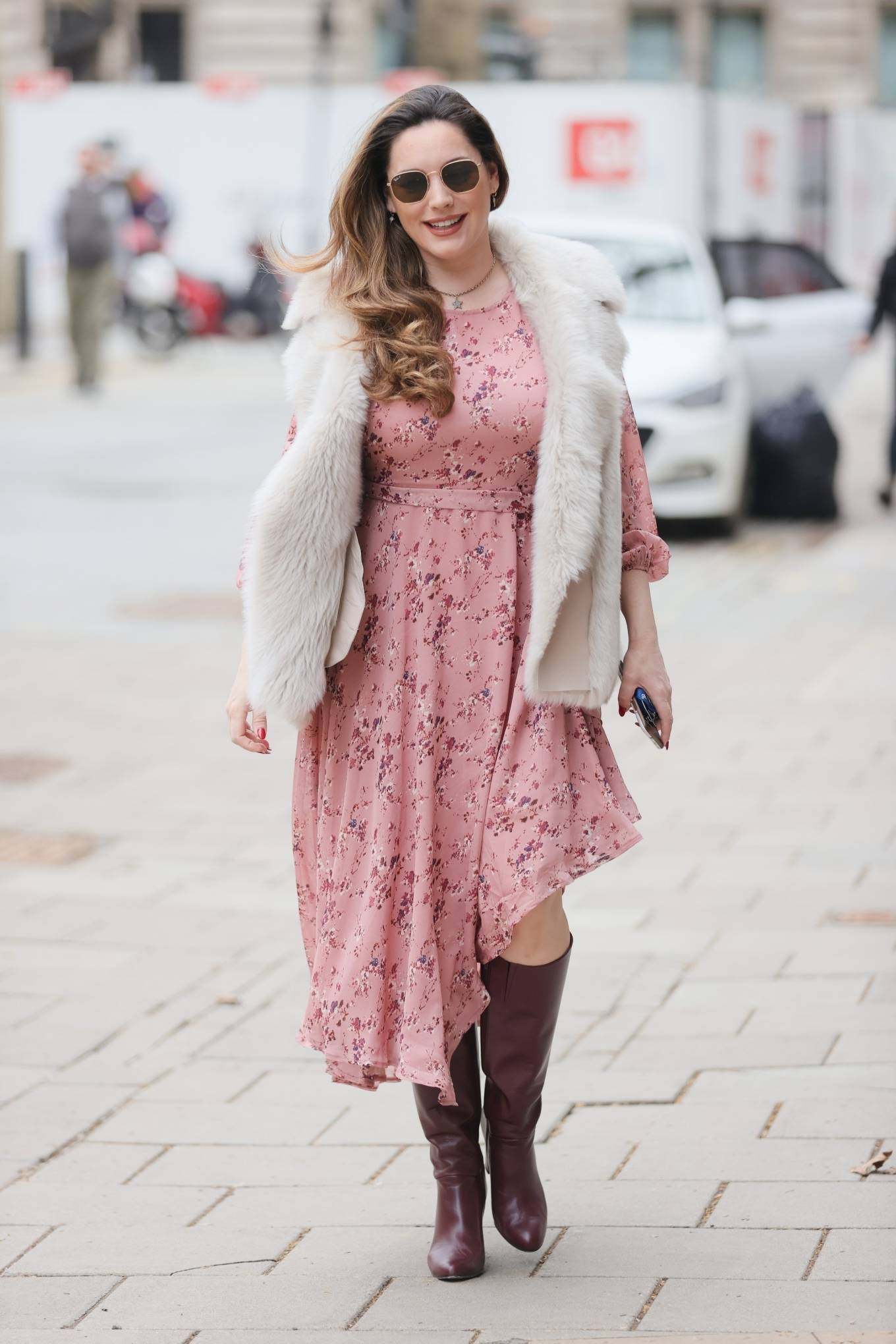 Kelly Brook - Looks stylish in a pink dress and leather boots at Heart radio in London